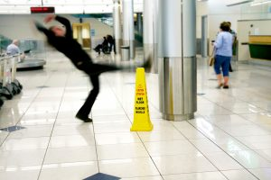 man falling on wet floor